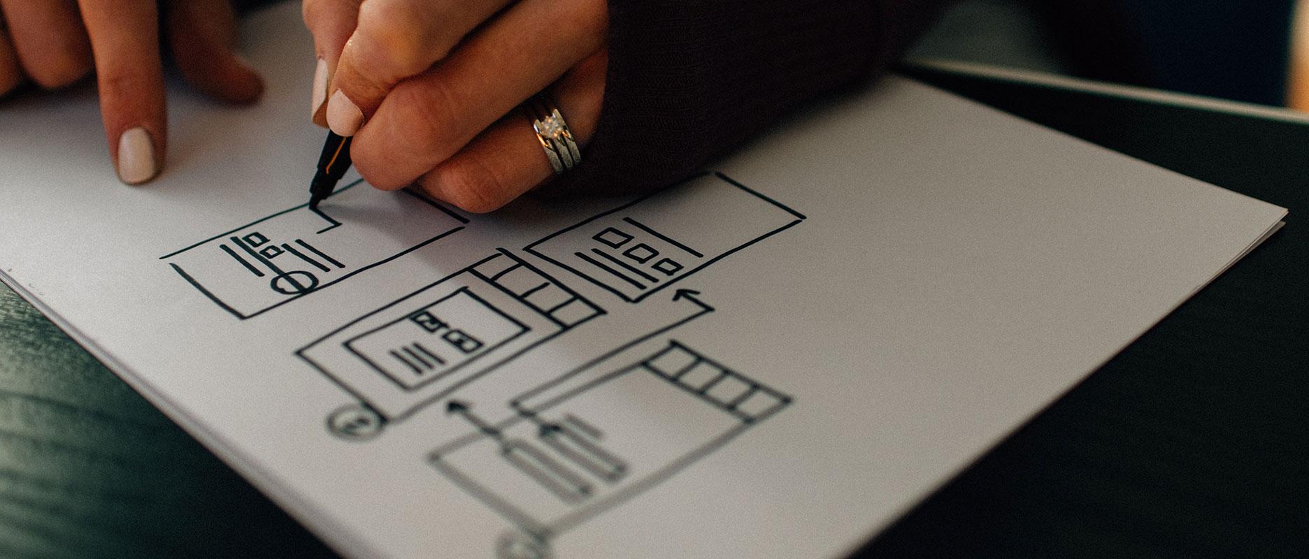 A person drawing a design scheme
